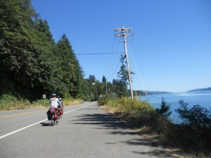 I got quite into taking photos while still on my bike. Hood Canal to the right, my two stalwart companions straight ahead